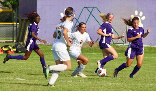 Delta freshman Addie Chester weaves through the defense during a game against Central this season.