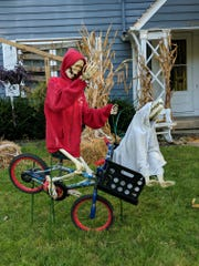"Sara and Chris Crigger decorate their home for Halloween through the month of October, changing the outfits of their two decorative skeletons. (Think ""Elf on the Shelf,"" but for Halloween.)"