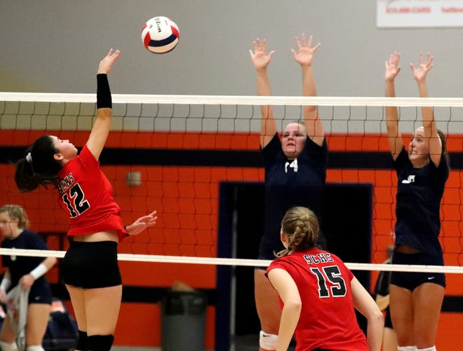 Stewarts Creek's Coralys Colon (12) hits the ball over the net while playing Blackman on the first day of the Dist. 7-AAA high school volleyball tournament held at Blackman, on Monday, Oct. 01, 2018.