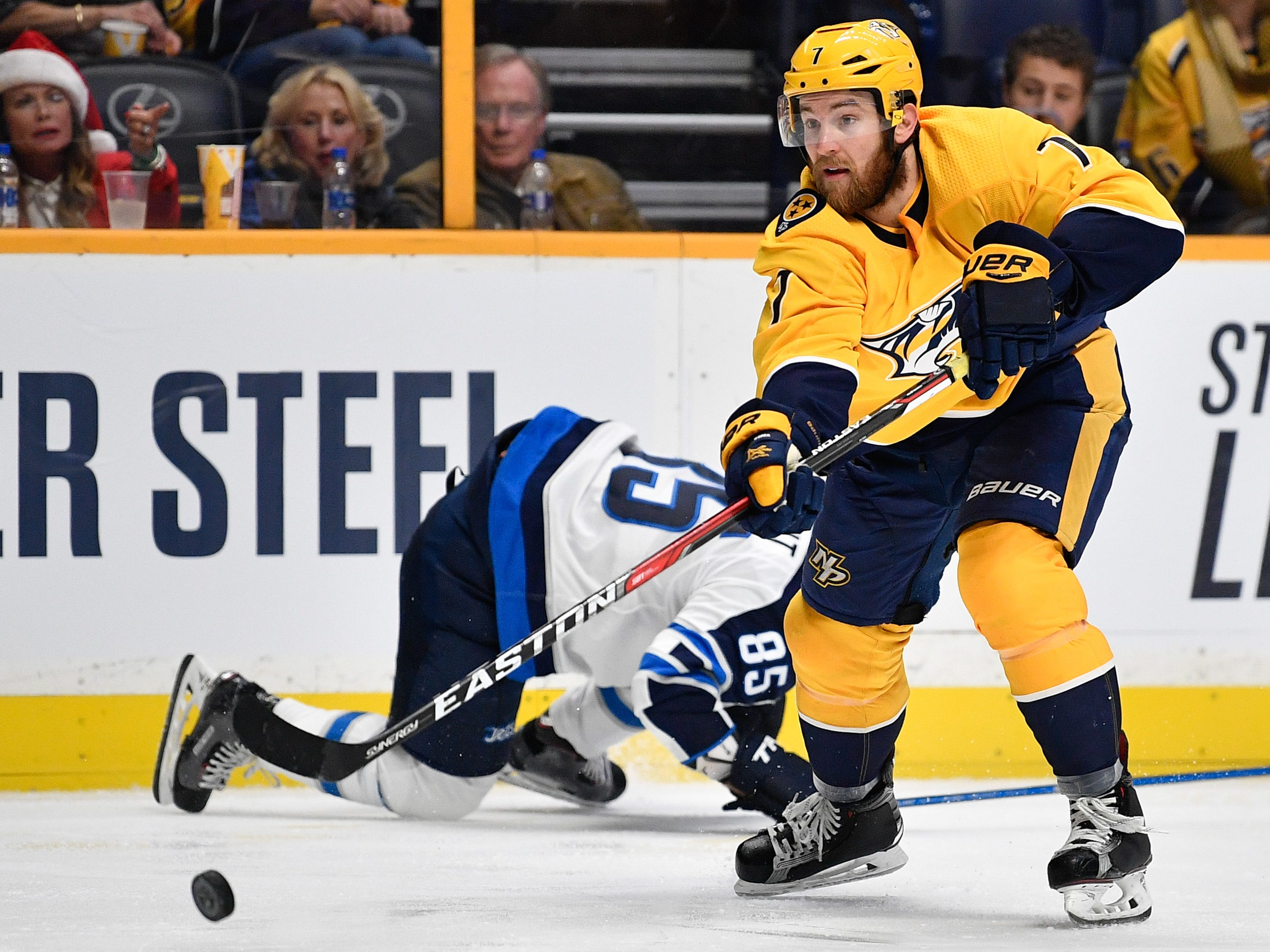 #7, Yannick Weber, Defenseman - Nashville Predators defenseman Yannick Weber (7) passes past Winnipeg Jets center Mathieu Perreault (85) during the third period at Bridgestone Arena in Nashville, Tenn., Tuesday, Dec. 19, 2017.