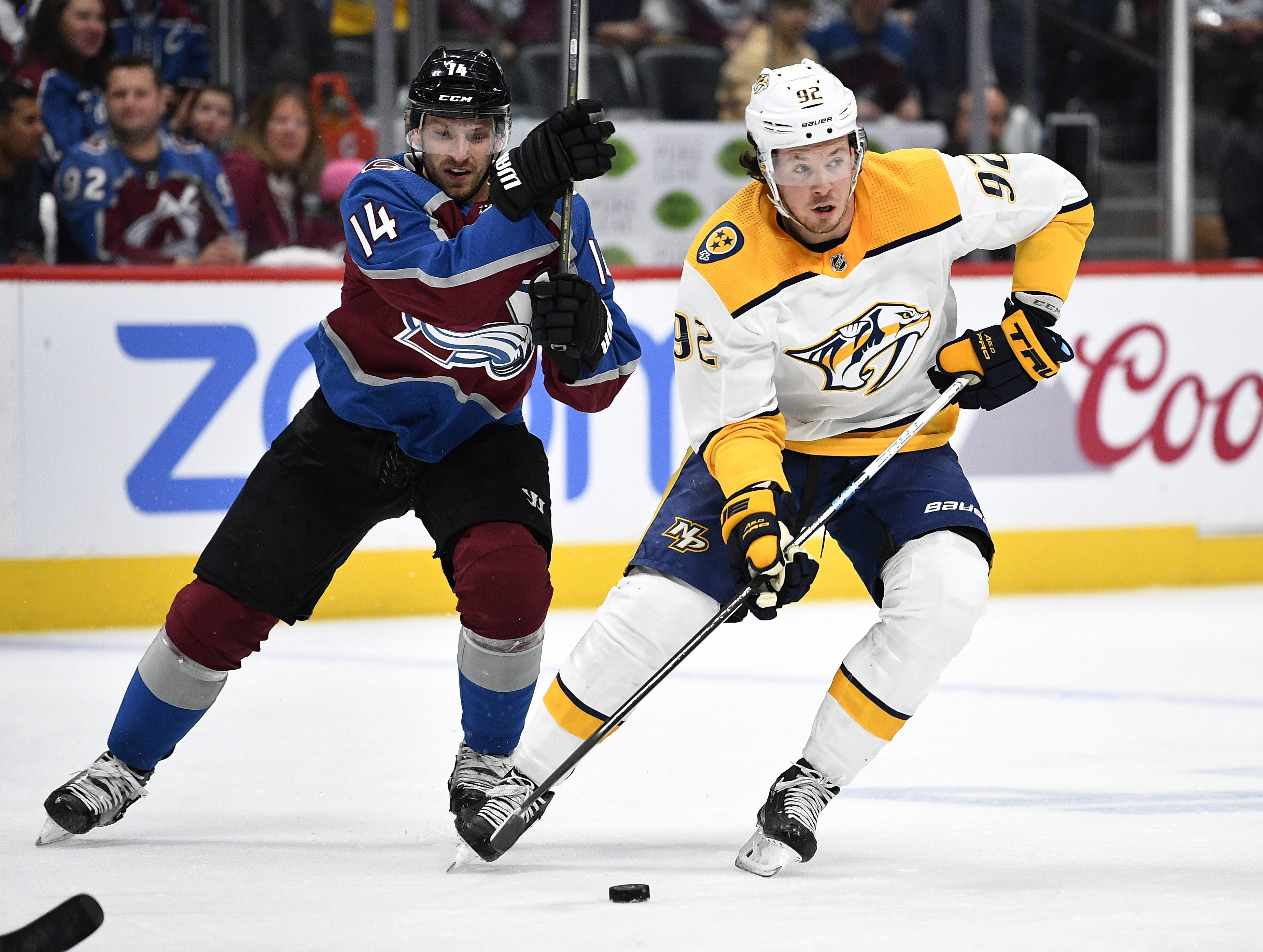 #92, Ryan Johansen, Forward - Nashville Predators center Ryan Johansen (92) moves the puck as Colorado Avalanche left wing Blake Comeau (14) defends during the first period of game 4 in the first round NHL Stanley Cup Playoffs at the Pepsi Center, Wednesday, April 18, 2018, in Denver, Colo.
