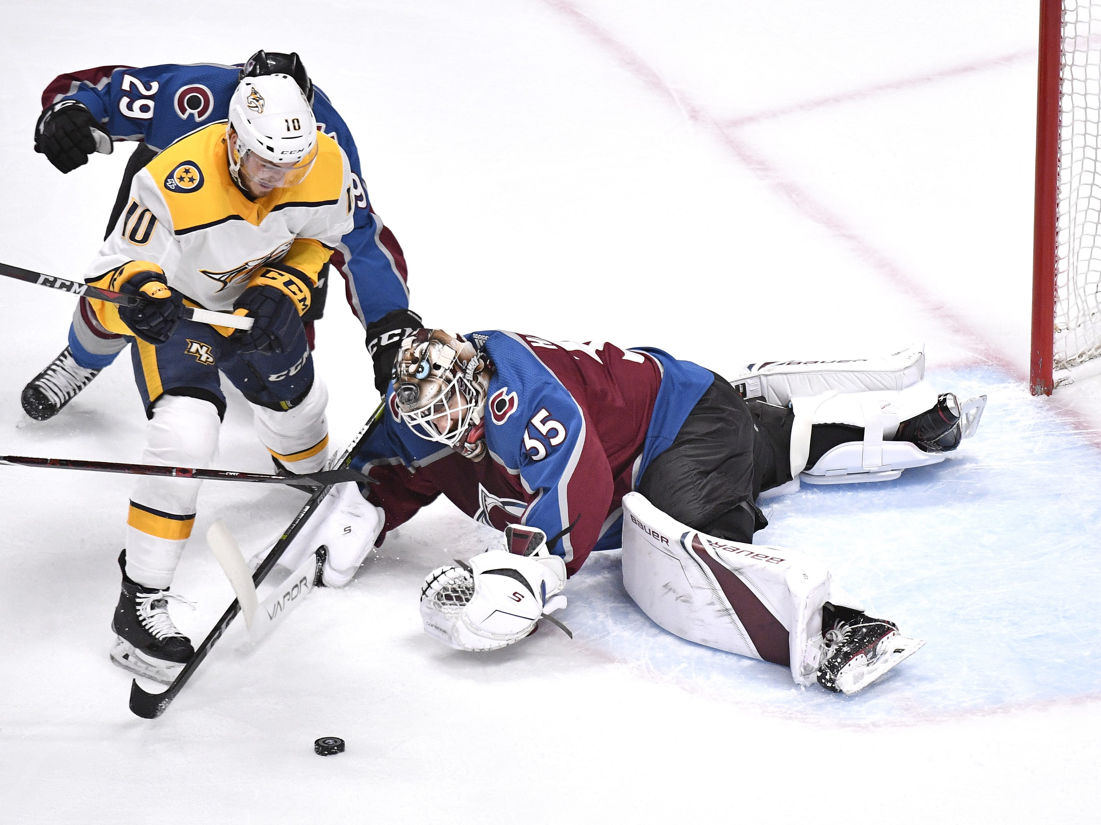 #10, Colton Sissons, Forward - Nashville Predators center Colton Sissons (10) gets past Colorado Avalanche goaltender Andrew Hammond (35) with a shot that hits the post during the first period of game 6 in the first round NHL Stanley Cup Playoffs at Pepsi Center, Sunday, April 22, 2018, in Denver, Colo.