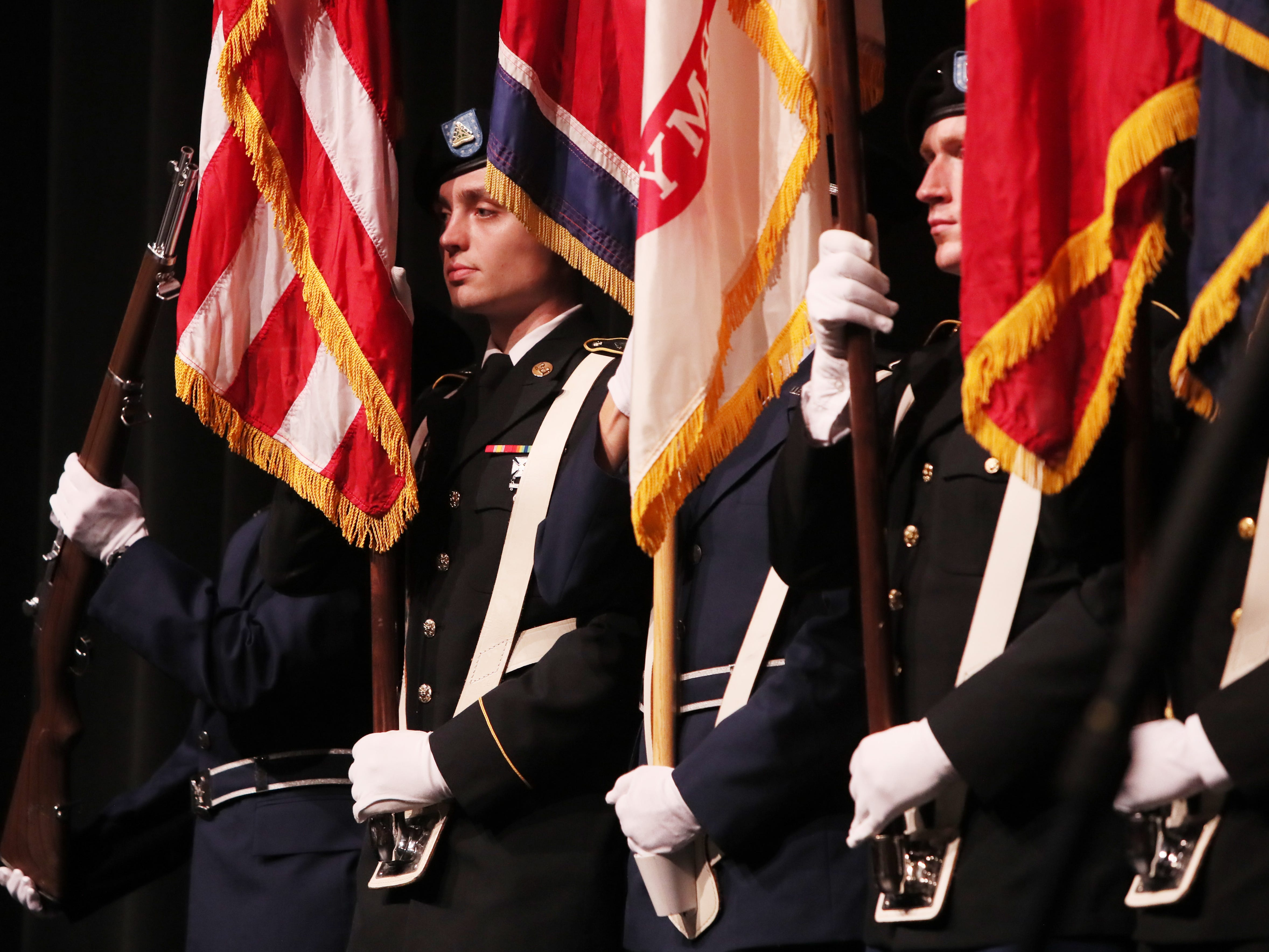 Cadets and midshipmen of the Army, Marines, Navy and Air Force ROTC programs at the University of Memphis present the colors before the start of the debate between Tennessee's gubernatorial candidates Democrat Karl Dean and Republican Bill Lee at the University of Memphis' Michael D. Rose Theater in Memphis, Tenn., on Tuesday, Oct. 2, 2018.