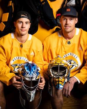 Predators goalies Juuse Saros, left, and Pekka Rinne pose for a portrait in the team locker room at Centennial Sportsplex.