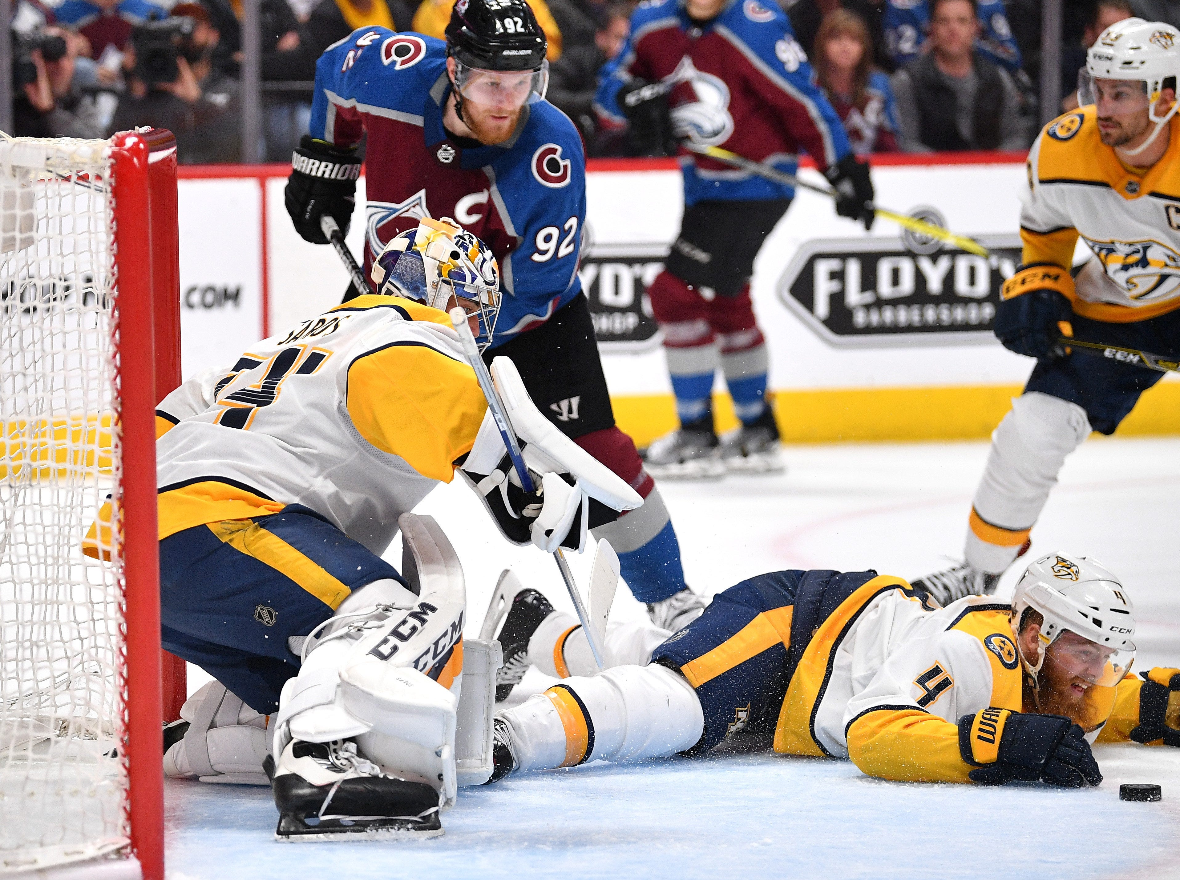 #4, Ryan Ellis, Defenseman - Nashville Predators defenseman Ryan Ellis (4) helps goaltender Juuse Saros (74) stop the puck during the second period of game 3 of the first round NHL Stanley Cup Playoffs at the Pepsi Center, Monday, April 16, 2018, in Denver, Colo.