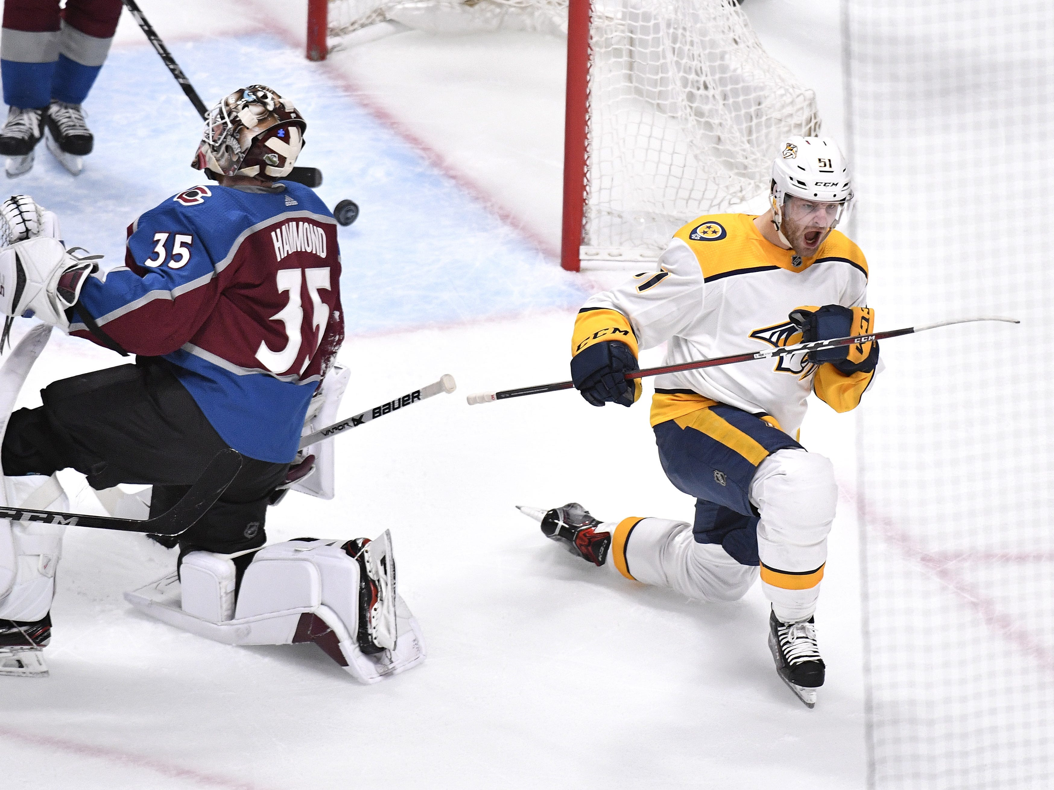 #51, Austin Watson, Forward - Nashville Predators left wing Austin Watson (51) reacts to his goal past Colorado Avalanche goaltender Andrew Hammond (35) during the first period of game 6 in the first round NHL Stanley Cup Playoffs at Pepsi Center, Sunday, April 22, 2018, in Denver, Colo.