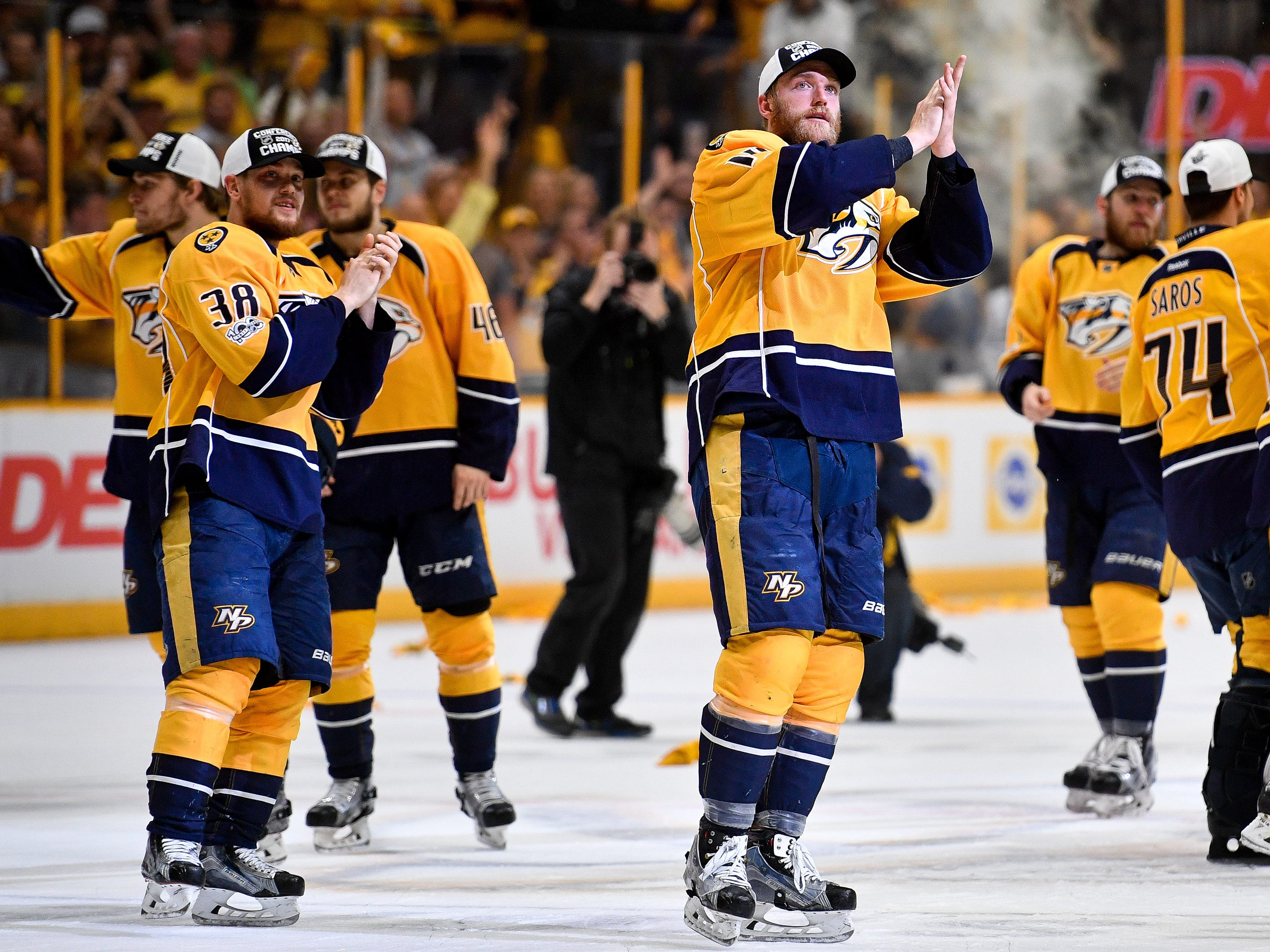 #14, Mattias Ekholm, Defenseman - Nashville Predators defenseman Mattias Ekholm (14) celebrates after the Nashville Predators' game 6 victory in the Western Conference final at Bridgestone Arena in Nashville, Tenn., Monday, May 22, 2017.
