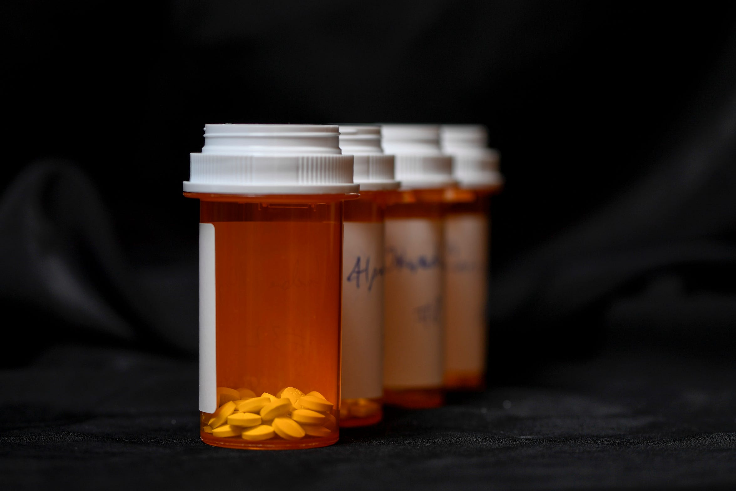 Nurse practitioner Christina Collins often prescribed her patients a worrisome mix of opioids and other drugs like muscle relaxers. This photo shows a daily dose of methadone, Roxicodone, Soma and Xanax, which Collins prescribed to a patient in 2011.