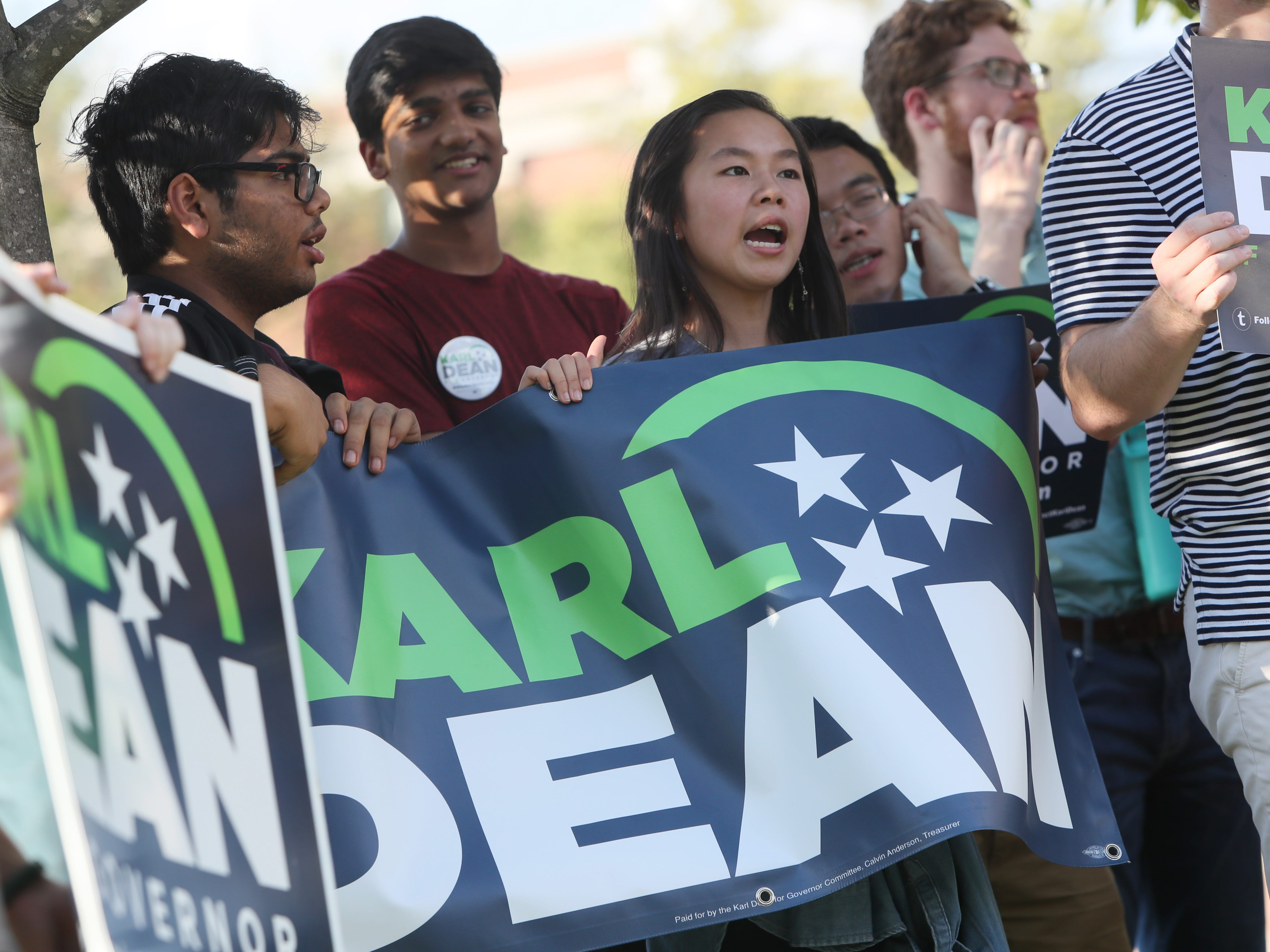 Karl Dean supporter Tina Nguyen cheers before the debate  between Dean and Bill Lee, at the University of Memphis' Michael D. Rose Theater Lecture Hall in Memphis, Tenn., on Tuesday, Oct. 2, 2018.