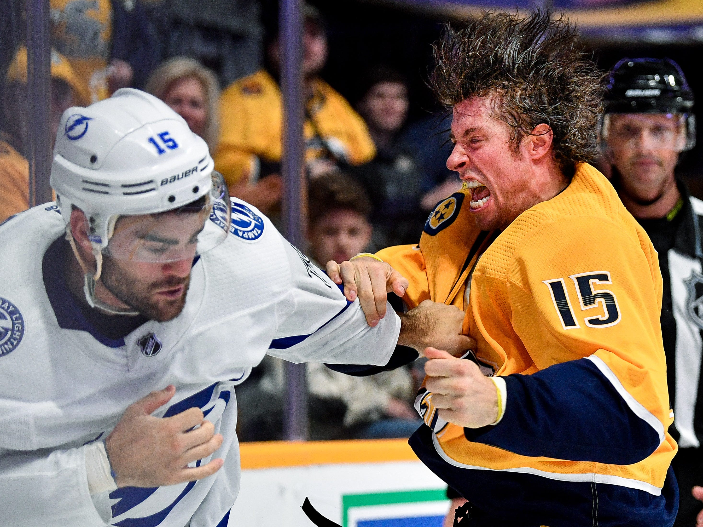 #15, Craig Smith, Forward - Nashville Predators forward Craig Smith (15) fights with Tampa Bay Lightning center Andy Andreoff (15) during the third period at Bridgestone Arena in Nashville, Tenn., Friday, Sept. 21, 2018.