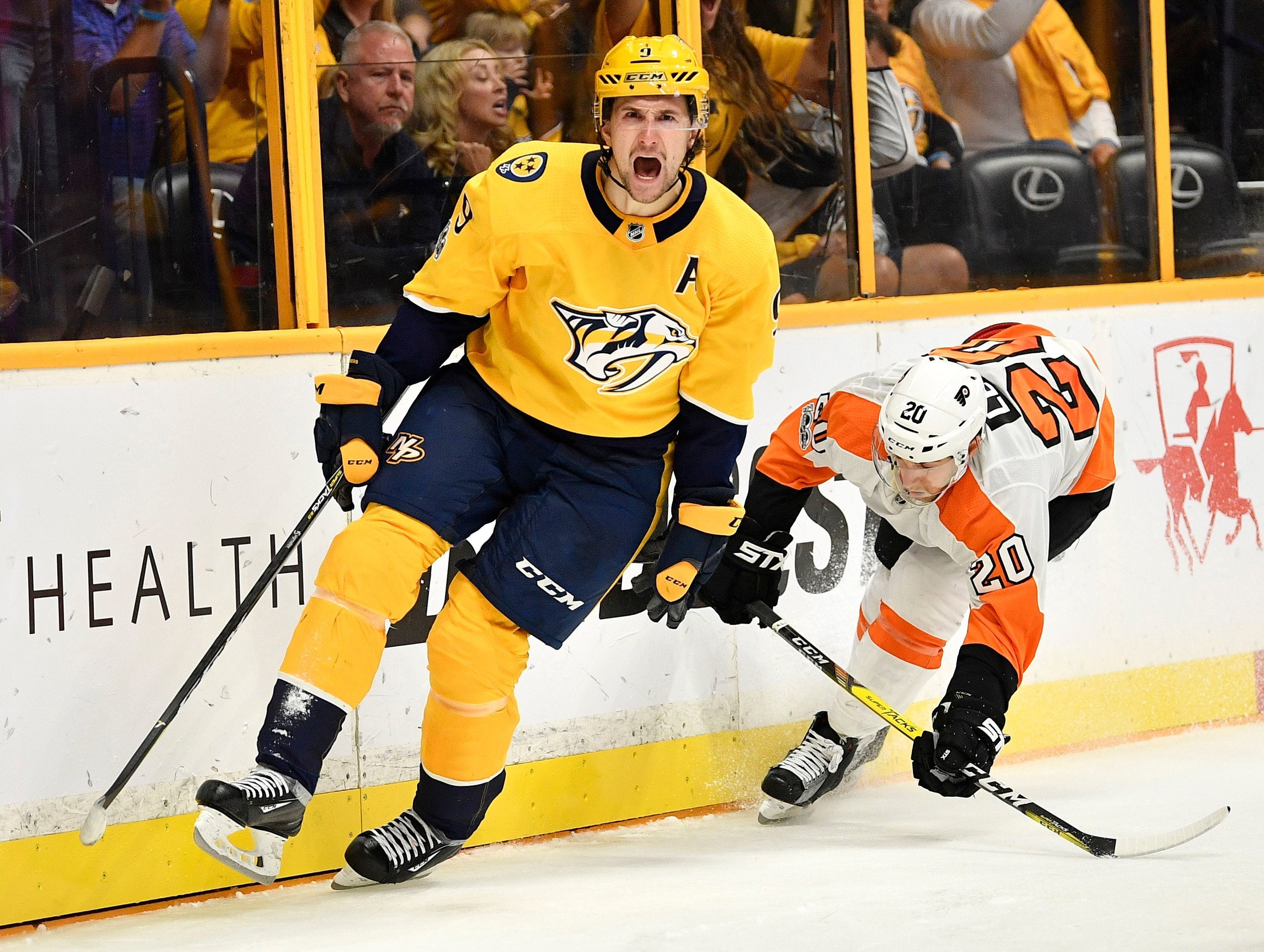 #9, Filip Forsberg, Forward - Nashville Predators left wing Filip Forsberg (9) celebrates his goal during the third period of the home opener at Bridgestone Arena in Nashville, Tenn., Tuesday, Oct. 10, 2017.