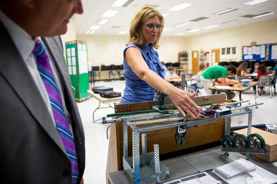 On Tuesday, October 2, 2018, at Oak Ridge Middle School in North Naples, Kari Doucette explains a machine her students built using money from a previous grant from Champions For Learning.