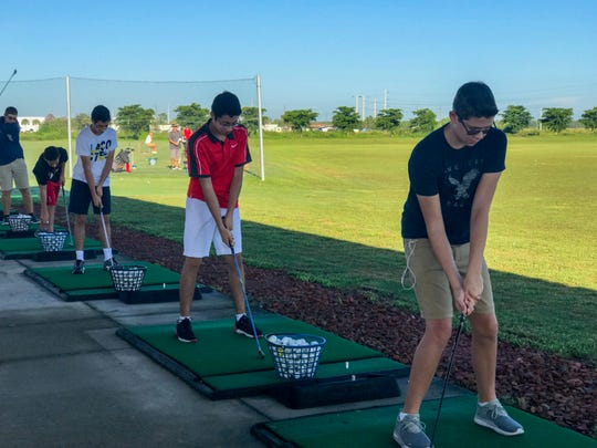 Students practice swinging a golf club at the driving range at Alico Family Golf during the STEM@Work kickoff event last week. More than 400 students were invited from Lee County high schools to participate in activities focused on Science, Technology, Engineering, Math, Career Planning, and Business Marketing.