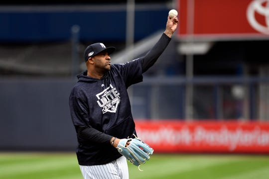 Yankees pitcher CC Sabathia throws the ball during a team workout at Yankee Stadium on Oct. 2.