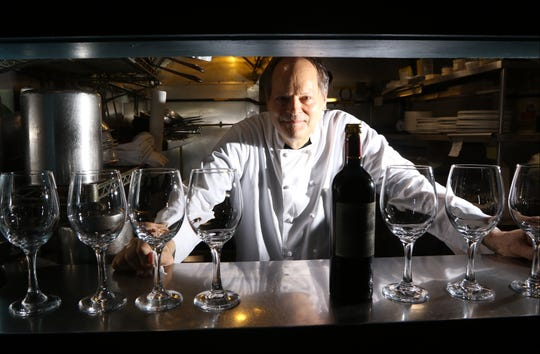 Chef and Owner of Cafe Matisse, Peter Loria, poses for a photo in Rutherford.  Loria runs a BYOB in  Rutherford where his staff is responsible for putting some bottles on ice and set tables with wine glasses. Thursday, September 27, 2018