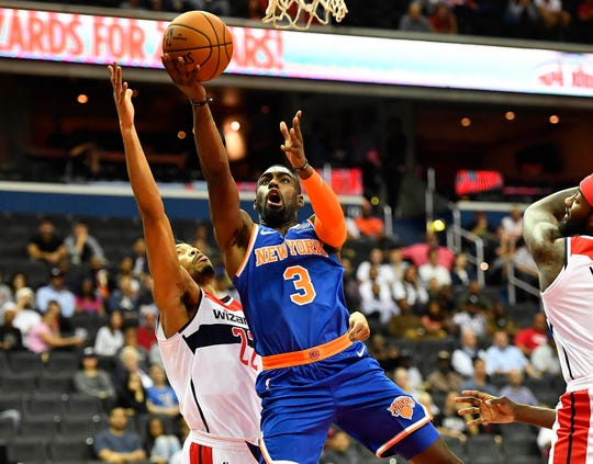 New York Knicks guard Tim Hardaway Jr. (3) shoots against Washington Wizards forward Otto Porter Jr. (22) during the first quarter at Capital One Arena.