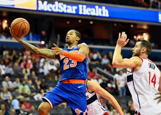 New York Knicks guard Trey Burke (23) shoots the ball against Washington Wizards forward Jason Smith (14) during the second quarter at Capital One Arena.