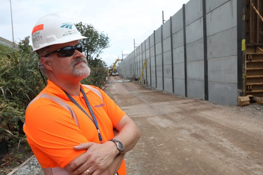 Scott Clinton, Amtrak manager of capital construction, is shown near the retaining wall that is being constructed. Once construction is completed the dirt road he is standing on will become an area of vegetation, similar to the land on the left. Tuesday, October 2, 2018