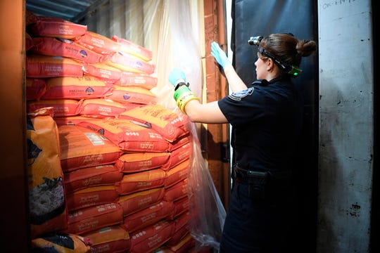 CBP Agriculture Specialist Rebecca Flinn inspects a cargo truck carrying rice at Salson Logistics in Newark, NJ on Wednesday, September 12, 2018.