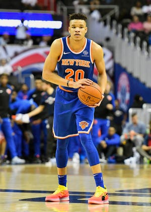 New York Knicks forward Kevin Knox (20) controls the ball against the Washington Wizards during the first quarter at Capital One Arena.