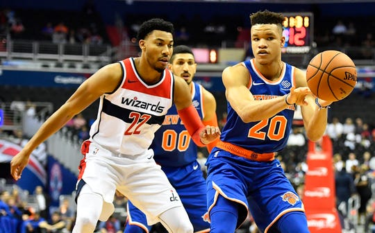 New York Knicks forward Kevin Knox (20) passes the ball against Washington Wizards forward Otto Porter Jr. (22) during the first quarter at Capital One Arena.