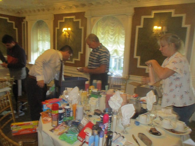 Members of the Paterson Rotary Club prepare care packages for homeless people in the city.
