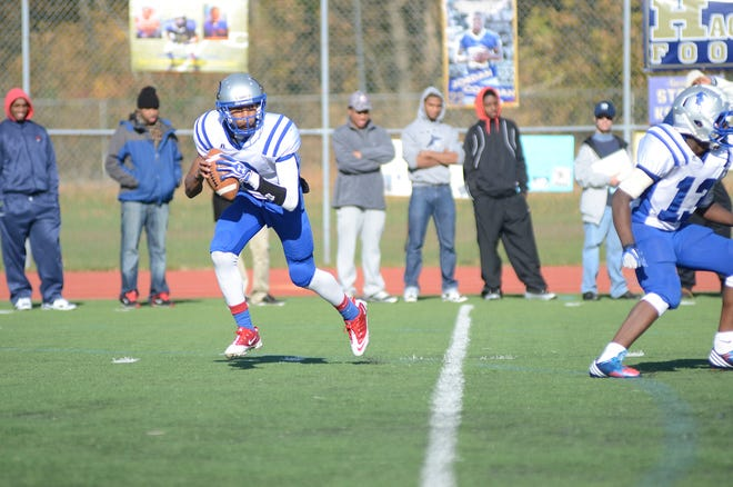 Teaneck QB Elijah Bethea looks for an open receiver during a 2012 game against Hackensack.