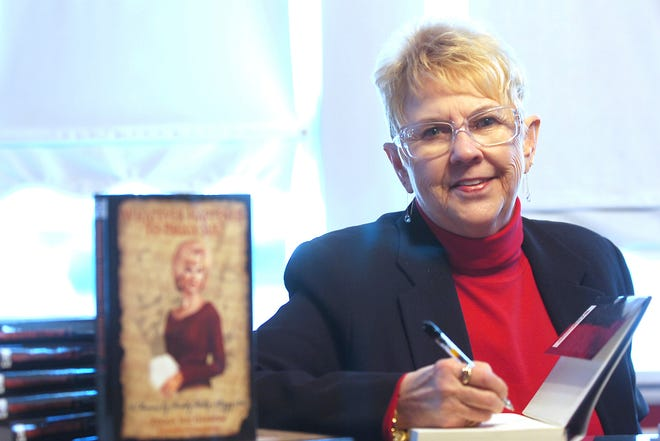 "In this Jan. 11, 2008, file photo, Peggy Sue Gerron unveils her new book ""What Ever Happened to Peggy Sue"" during a press conference in Tyler, Texas. Gerron, the Texas woman who inspired the 1958 Buddy Holly song ""Peggy Sue"" has died at a Lubbock hospital. Gerron Rackham of Lubbock died Monday, Oct. 1, 2018, at University Medical Center. She was 78. (Jaime R. Carrero/Tyler Morning Telegraph, via AP, File)"
