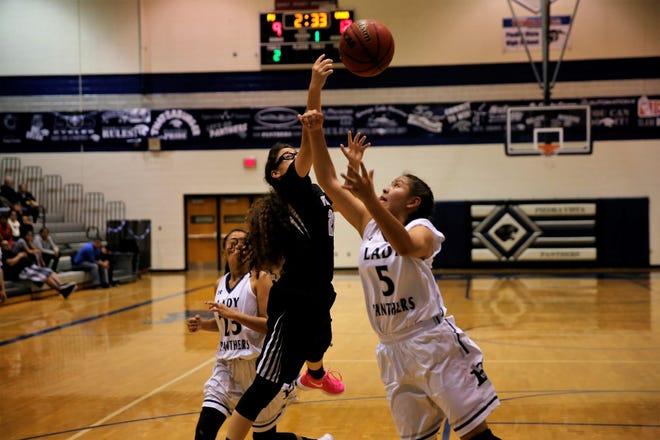 Volcano Vista's Saige Gomez and Piedra Vista's Alexis Long fight for a rebound during a district game on Feb. 17 at the Jerry A. Conner Fieldhouse. The Panthers will host Kirtland Central in the season opener on Dec. 4.