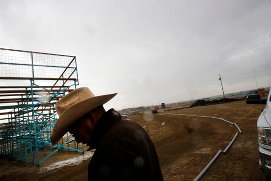 Floyd Benally, rodeo coordinator with the Northern Navajo Fair, oversees an electrical wiring project as crew members prepare the rodeo ring for the Northern Navajo Nation Fair Tuesday at the Northern Navajo Nation Fairgrounds in Shiprock.