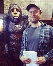 Dylan Taylor-Lehman and a friend at a Ohio Big Foot conference he covered.
