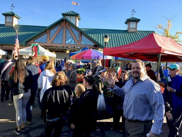 Antonio Rugiero, owner of Antonio's Cucicna Italiana in Farmington Hills (along with several metro Detroit area locations) enjoys the old-world flavor and busy feel of  the farmers market on Italian American Day.
