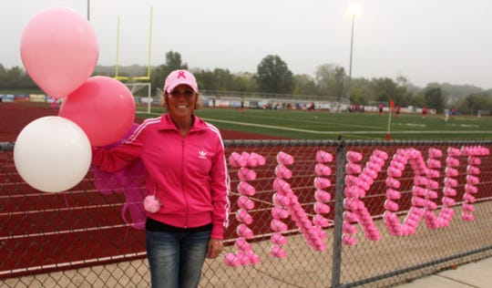South Lyon Soccer Boosters Club President Andrea DeSantis helped organize the second-annual Pink Out game Monday against district rival South Lyon East on the first day of Breast Cancer Awareness Month.