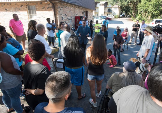 Escambia County Commissioner Doug Underhill meets with residents of the Wellington Arms Apartment complex on Tuesday, Oct. 2, 2018. The residents of the apartment complex recently had their water cut off because the building's owners were five months behind in paying the utilities and more than $22,000 in debt.