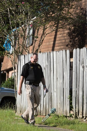 Escambia County Code Enforcement Officer Sgt. Steve Kenney inspects the Wellington Arms Apartment complex on Tuesday, Oct. 2, 2018. The residents of the apartment complex recently had their water cut off because the building's owners were five months behind in paying the utilities and more than $22,000 in debt.