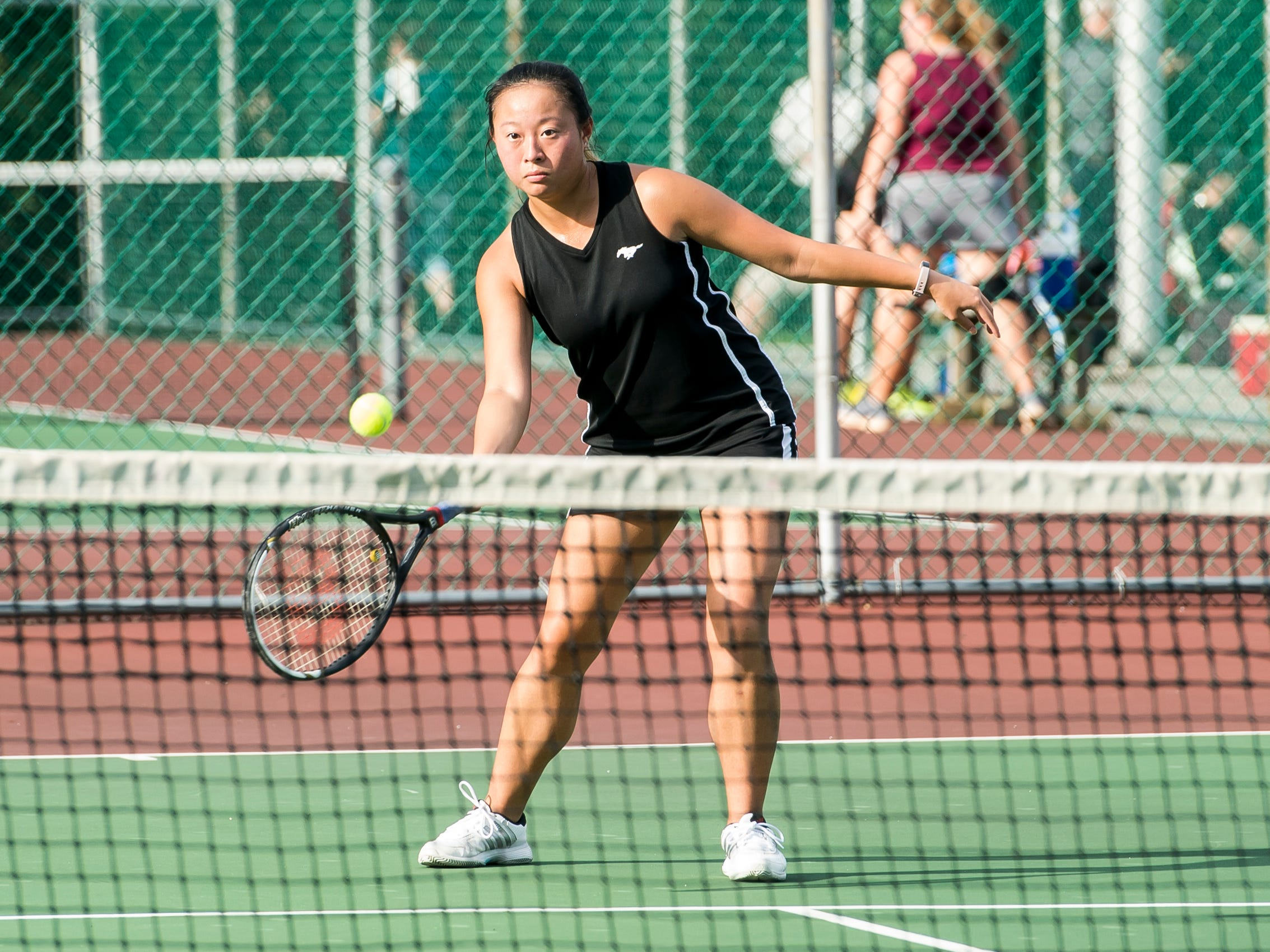 South Western's Karen Yang returns the ball to New Oxford's Maddie Markle while playing in the No. 3 singles match on Wednesday, September 26, 2018. Yang won 7-5, 5-7, 10-6.