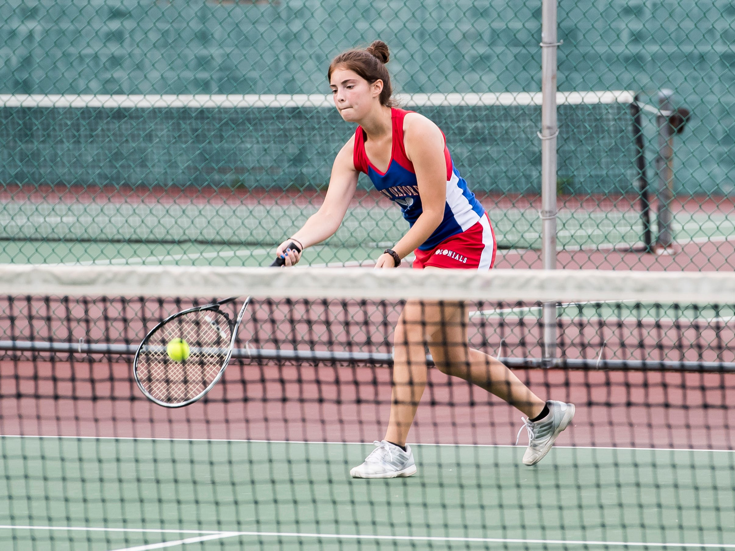 New Oxford's Maddie Markle returns the ball to South Western's Karen Yang in the No. 3 singles match on Tuesday, October 2, 2018.