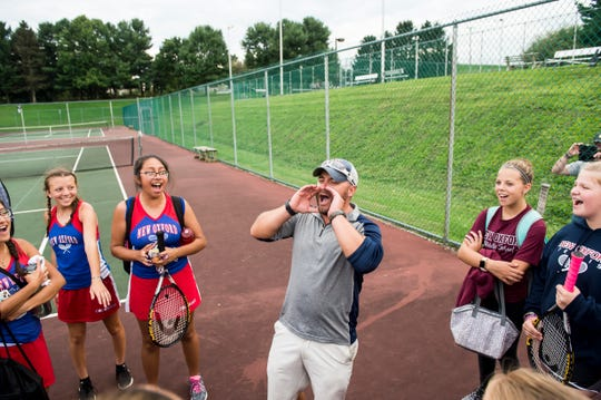 New Oxford tennis coach Travis Martin leads his team in a victory cheer after the Colonials defeated South Western and claimed a share of the YAIAA Division 1 title on Tuesday, October 2, 2018.