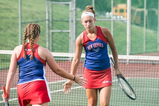 New Oxford's Eryn Little, right, and Molly Socks celebrate a point during the No. 1 doubles match against South Western on Tuesday, October 2, 2018. The pair won 6-4, 6-2.