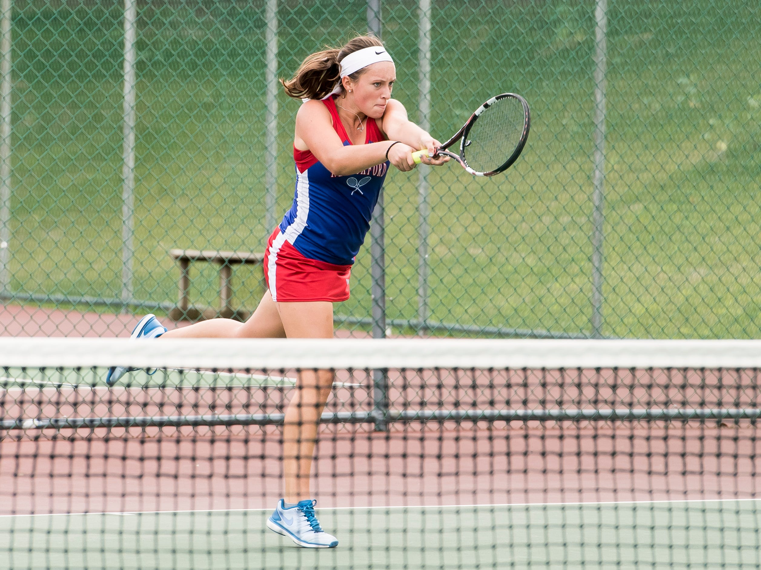New Oxford's Kasi Conjack follows through on a swing during the No. 2 singles match against South Western's Emma Hynson on Tuesday, October 2, 2018. Conjack won 3-6, 6-3, 6-2.