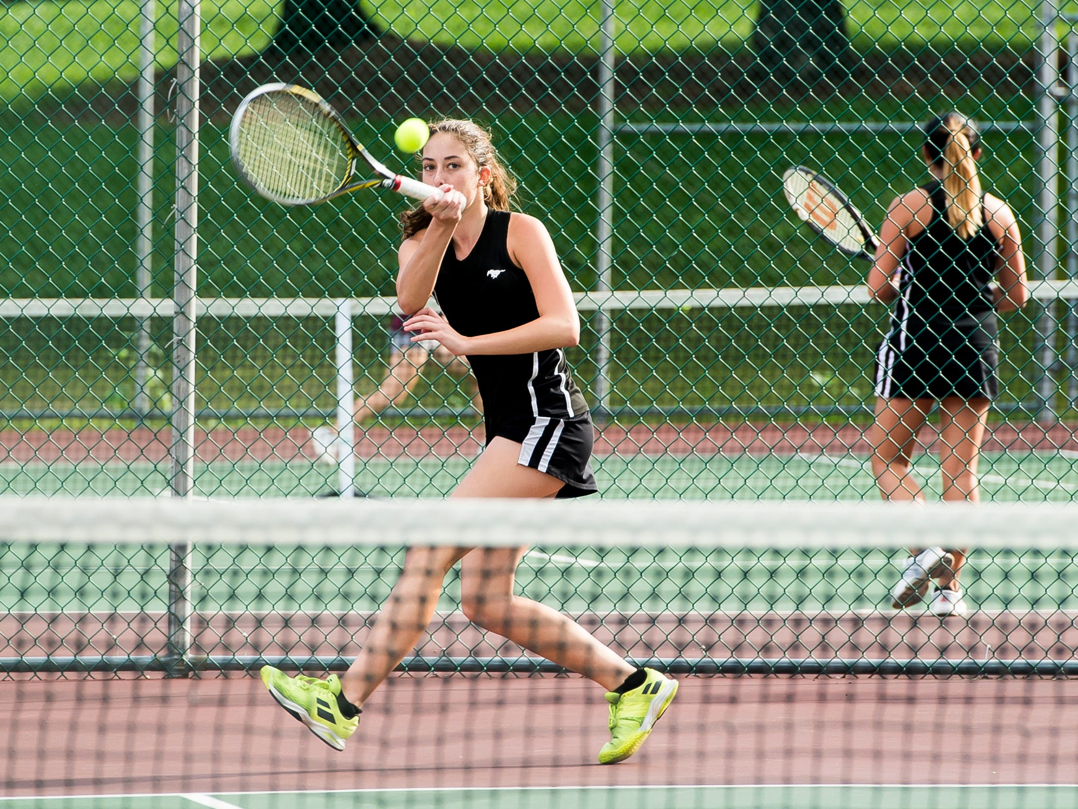 South Western's Michaela Sentz returns the ball to New Oxford's Kamdyn Balko while playing in the No. 1 singles match on Wednesday, September 26, 2018. Sentz won 6-3, 7-6 (2).