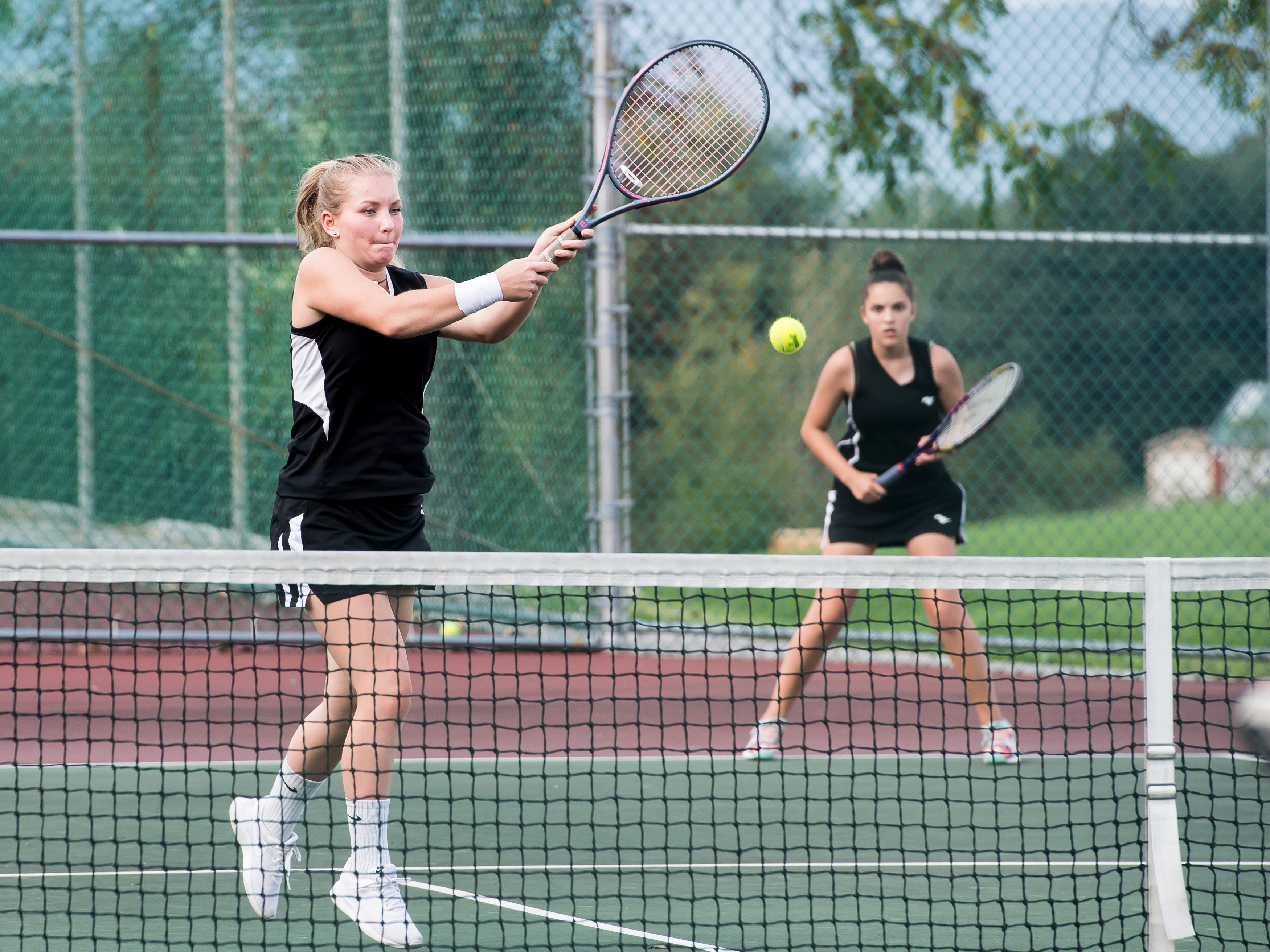 South Western's Skylar Zepp hits the ball during the No. 2 doubles match against New Oxford on Tuesday, October 2, 2018.