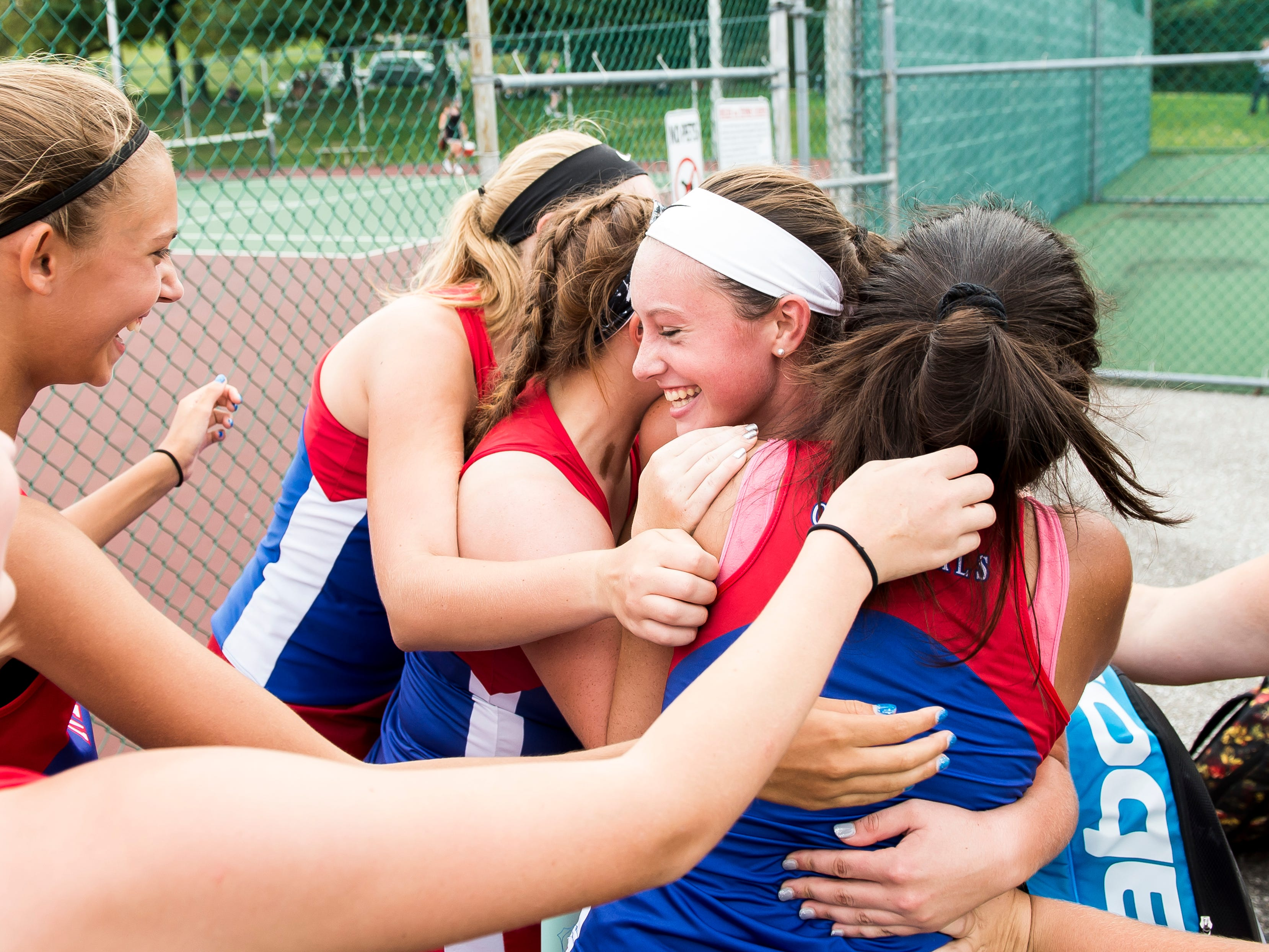 New Oxford's Kasi Conjack, center, is mobbed by her teammates after she won the No. 2 singles match against South Western on Tuesday, October 2, 2018. Conjack's victory gave New Oxford the match win against the Mustangs and handed the Colonials a share of the YAIAA Division I girls tennis championship title, a first for the program.