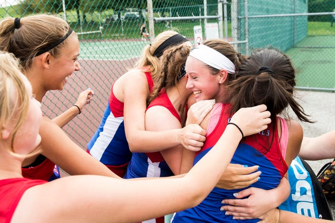 New Oxford's Kasi Conjack, center, is mobbed by her teammates after she won the No. 2 singles match against South Western on Tuesday, October 2, 2018.
