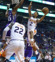 Suns' Elie Okobo (2) goes up for a layup against Kings' Marvin Bagley III (35) during the first half at Talking Stick Resort Arena in Phoenix, Ariz. on October 1, 2018.