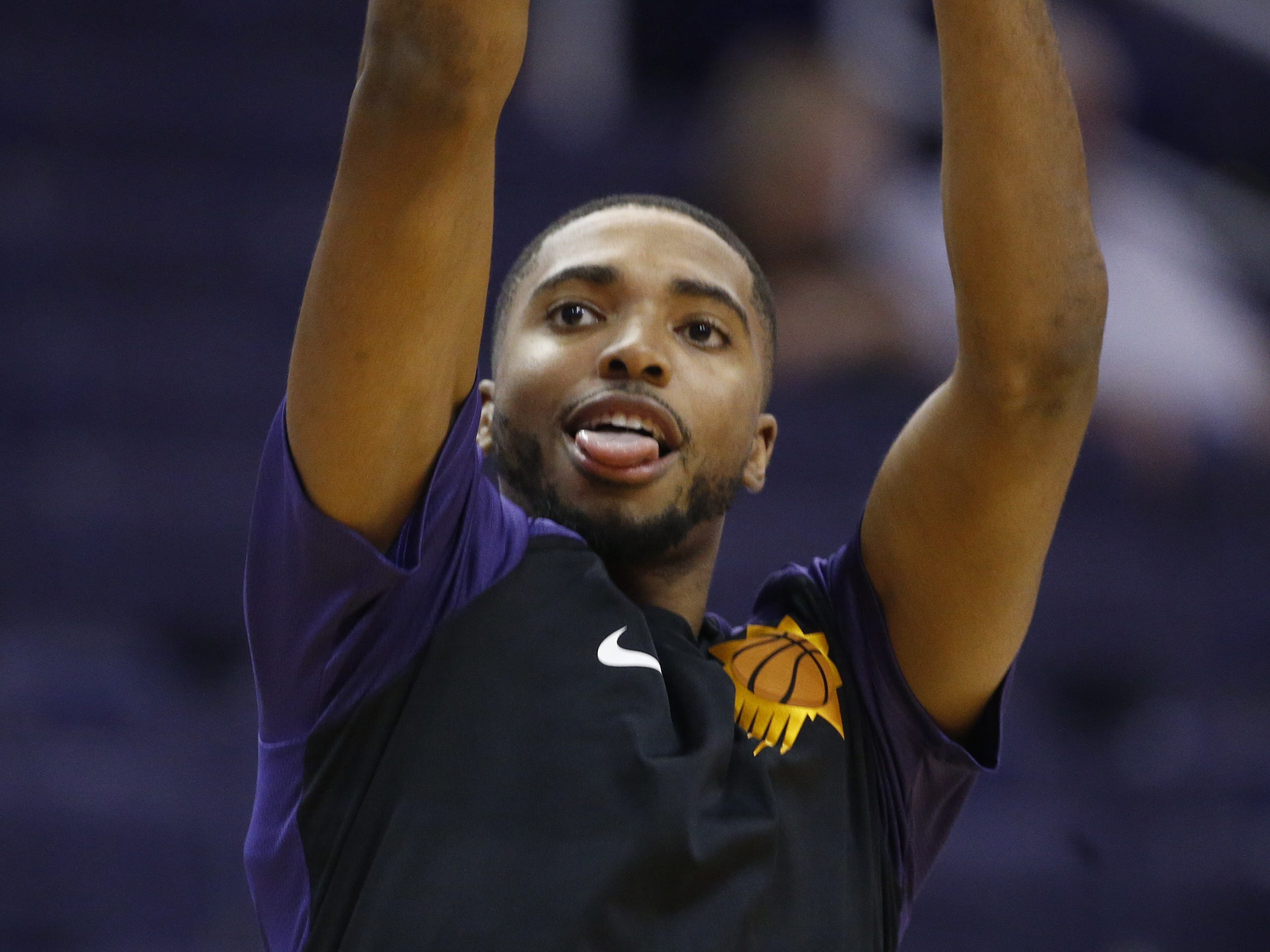 Suns Mikal Bridges (25) shoots before a game against the Kings at Talking Stick Resort Arena in Phoenix, Ariz. on October 1, 2018.