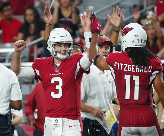 Arizona Cardinals quarterback Josh Rosen (3) and wide receiver Larry Fitzgerald (11) high-five during the game against the Seattle Seahawks on Sept. 30, 2018.