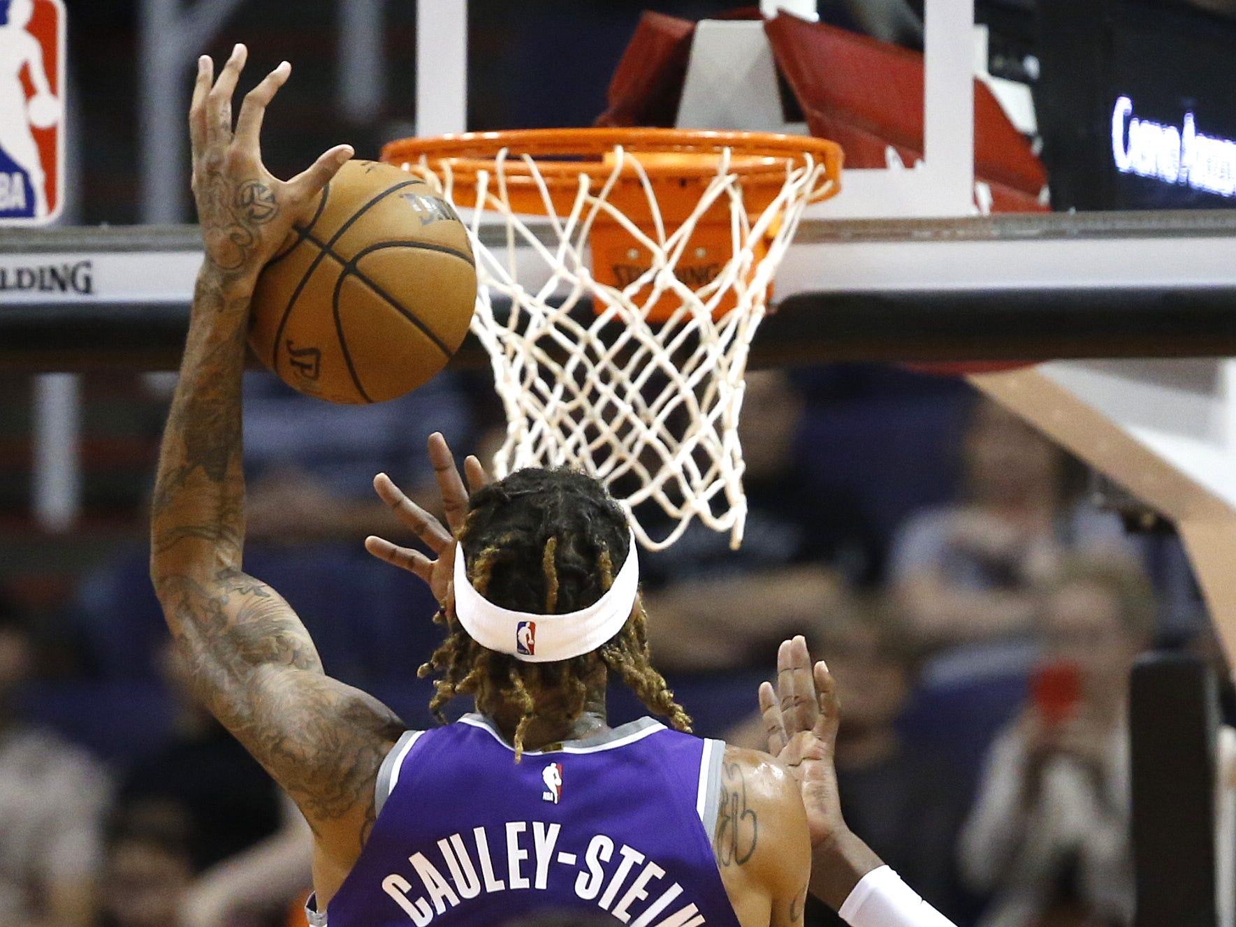 Suns Deandre Ayton (22) blocks Kings Willie Cauley-Stein (00) during the first half at Talking Stick Resort Arena in Phoenix, Ariz. on October 1, 2018.