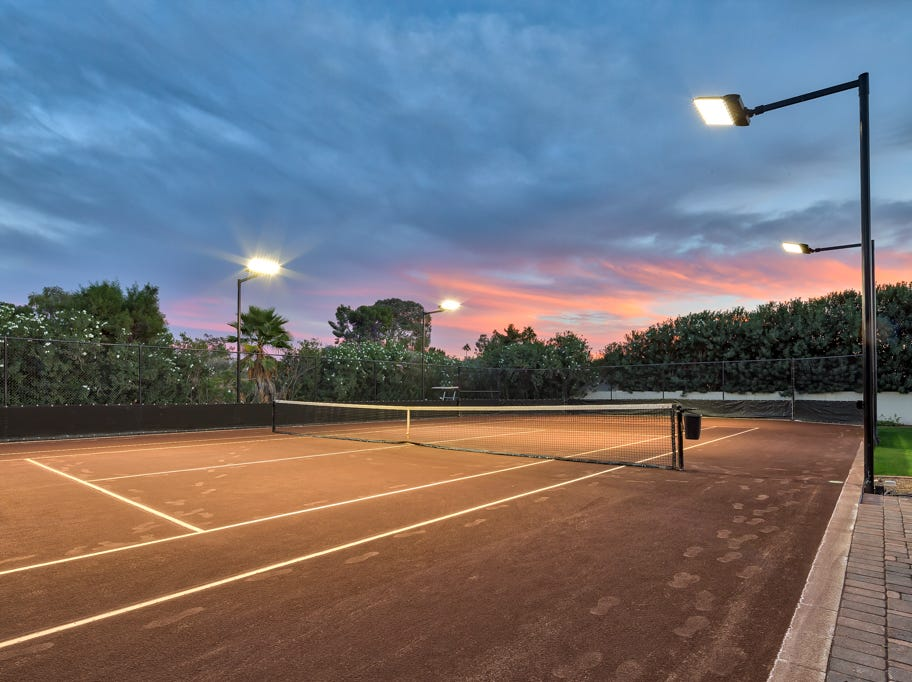 The backyard features a $80,000 lighted, European hydro clay tennis court.
