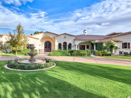 Ivan Osorio, a neurologist practicing in Kansas City, and his wife Sheryl, purchased a 8,600-square-foot mansion in Scottsdale's Paradise Valley Farms community.